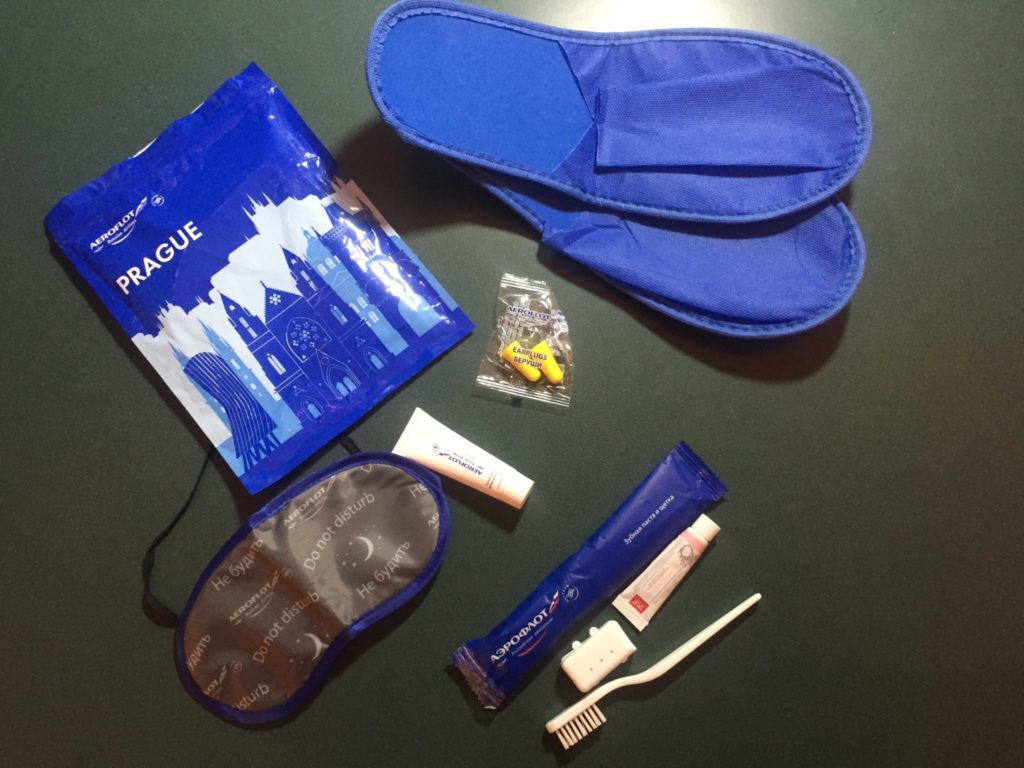 Amenity kit with sleep mask, slippers and tooth brush