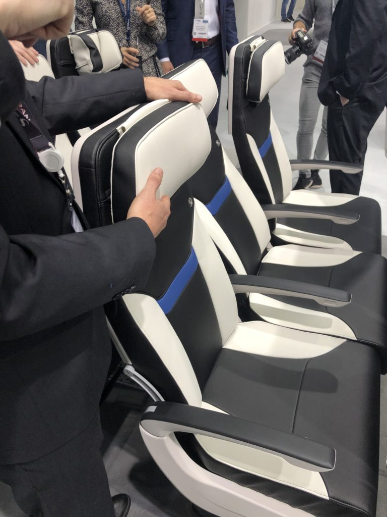 The new Z400 economy class seat headrest moves up and down