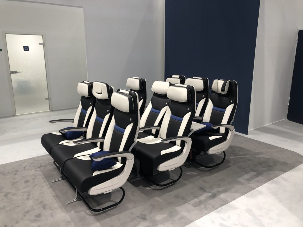 Three rows of Z400 seats on the show floor of the Aircraft Interiors Expo