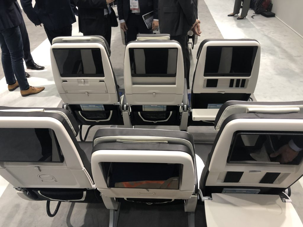Two rows of Z400 economy class seats with seatback IFE