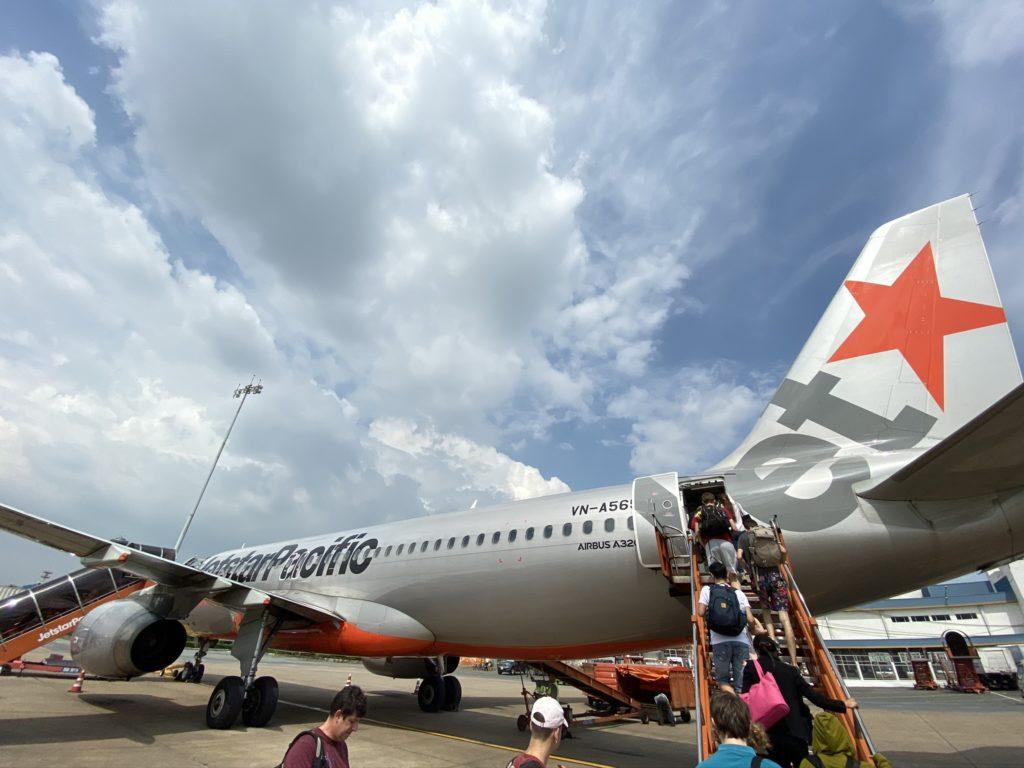Passengers loading jetstar aircraft on the tarmac