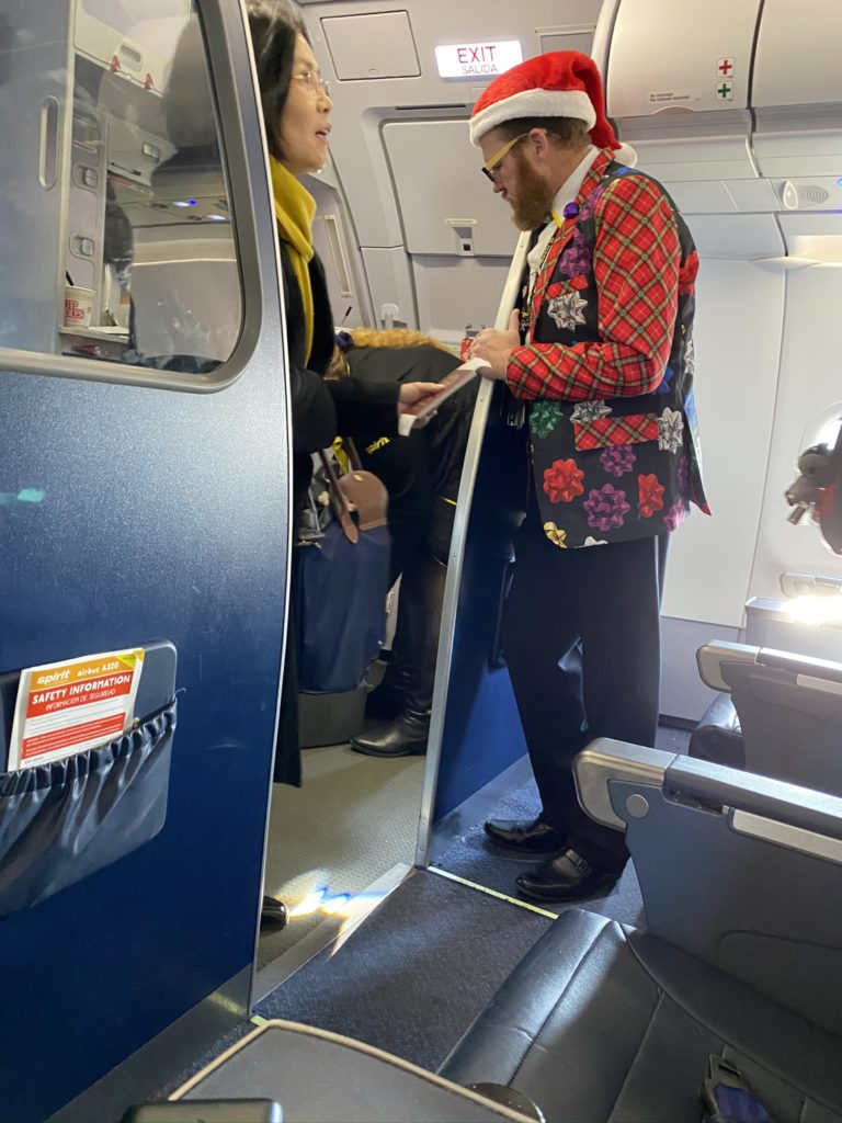 Festive Cabin Crew dressed and greeting passengers