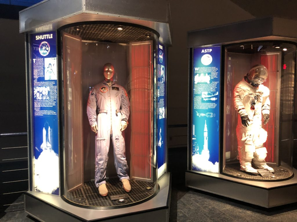 spacesuits on display in the museum
