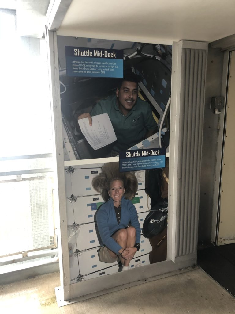 Display images of astronauts in the shuttle deck