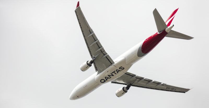 belly of a qantas aircraft in the sky