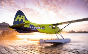 MagniX seaplane on the water at sunset