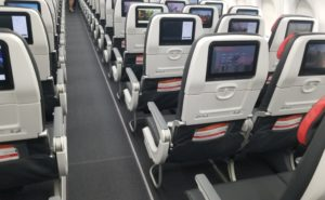 Rows of seats with seatback IFE on the Air Canada A220-300