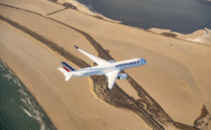 Air france airbus flying over beach area