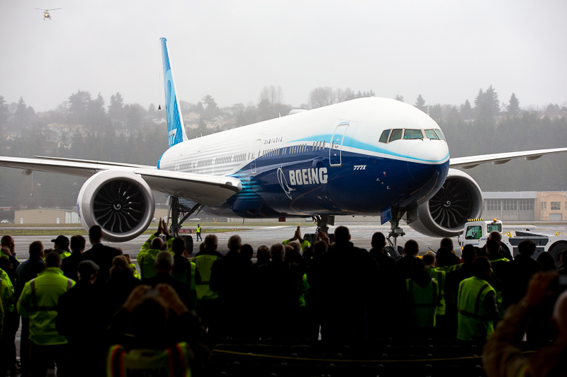 The 777X lands safely, as a robust crowd watches