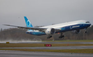 777X takes its maiden flight, rising above the earth