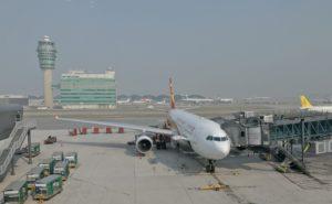 Hong Kong Airlines at an airport gate