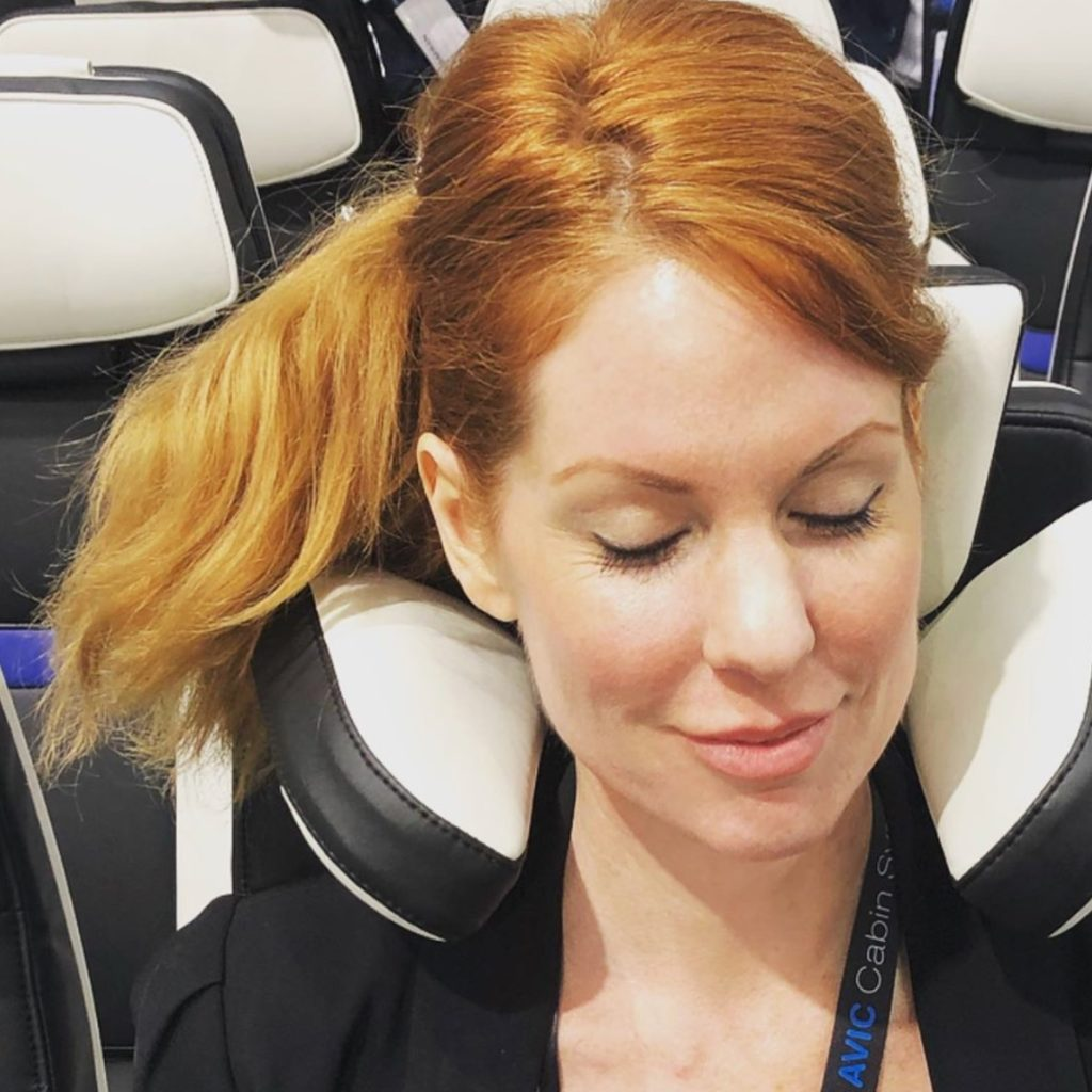 Runway Girl Network editor Mary Kirby trying the new Z400 pillow headrest