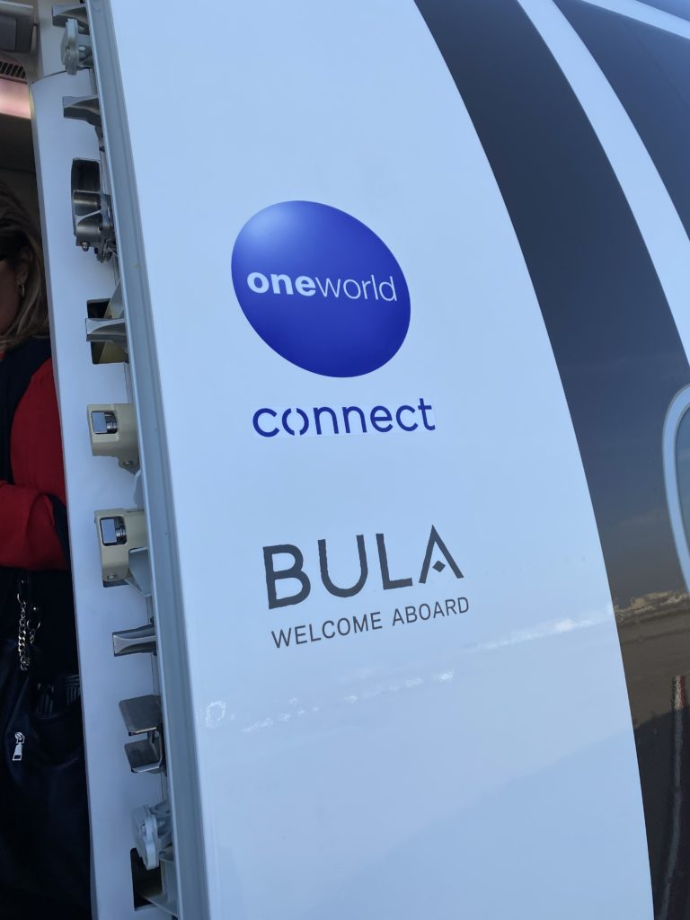 """Fiji Airways is a member of oneworld, and the oneworld logo shown here greets passengers, as well as the words """"BULA welcome aboard"""""""