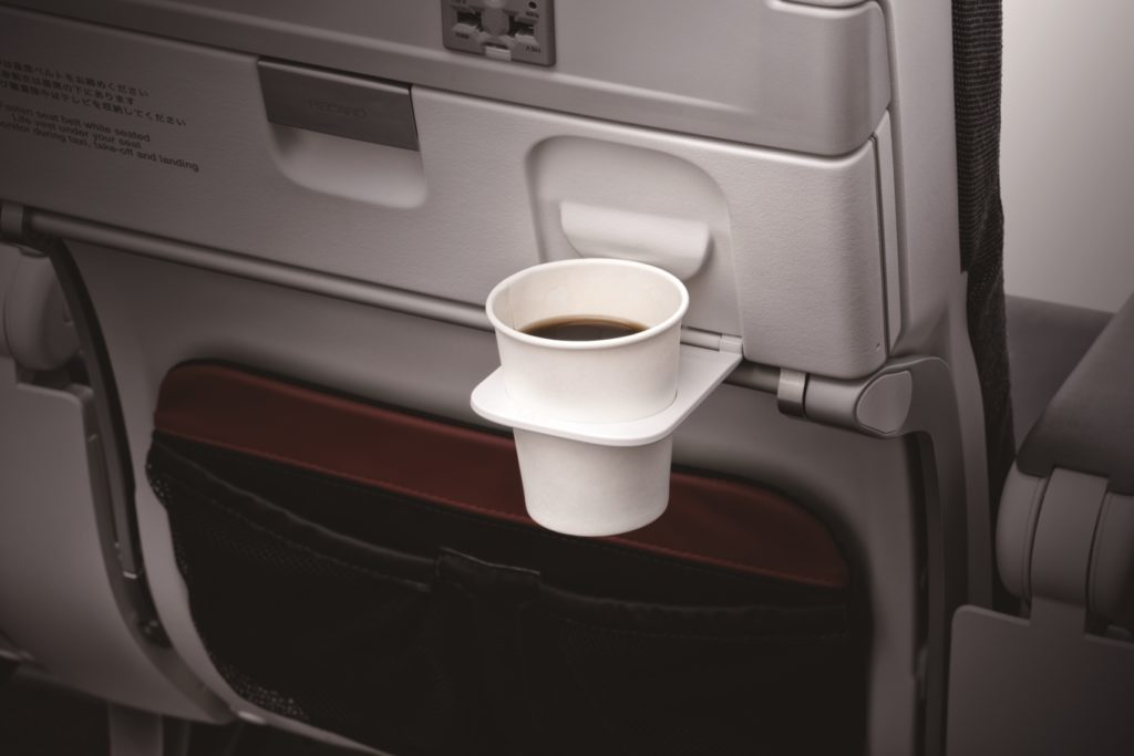JAL seatback displaying cup holder