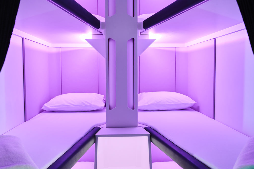 An empty Skynest with pillow, mattress and purple LED lighting
