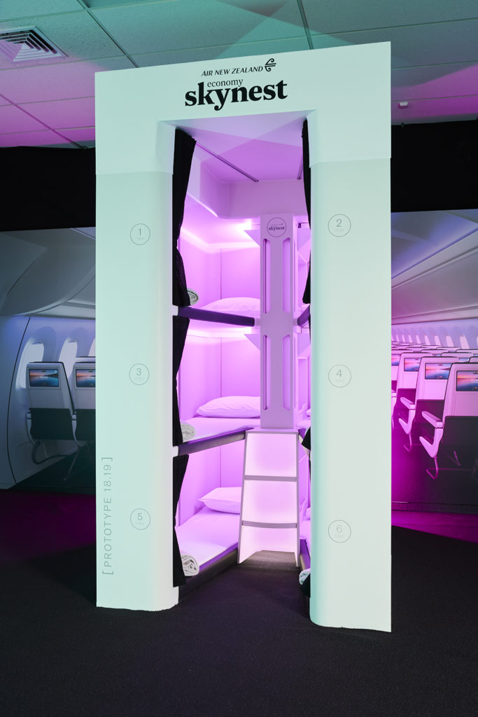 Skynest stacked pods in the middle of a widebody aircraft cabin