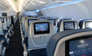 Interior of Delta A321. Rows of seats with seatback IFE system