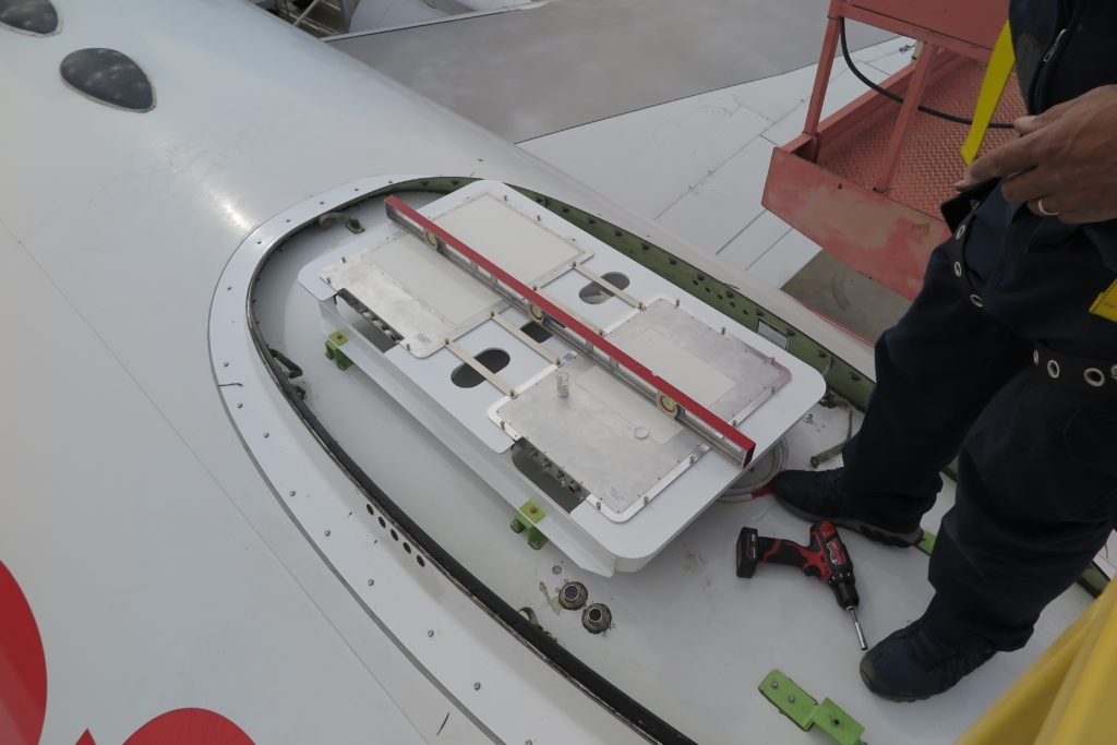 The Gilat ESA being installed on Honeywell's 757 testbed. The antenna is flat.