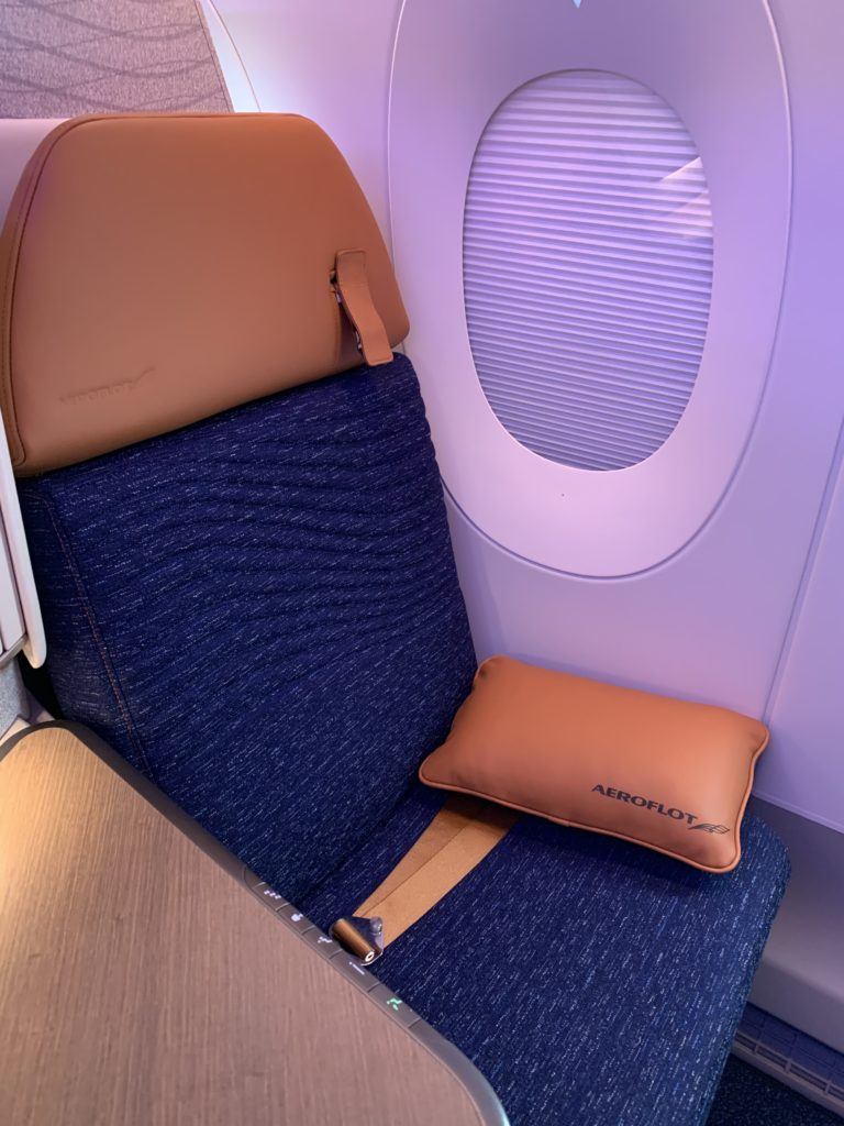 Aeroflo's Horizon suite with blue fabric and bronze accents, pictured, is made by Collins Aerospace.