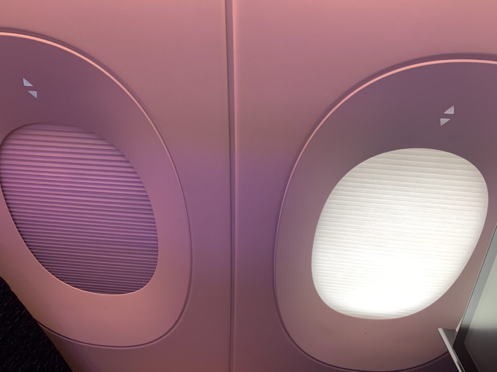 Aircraft windows showing the touch shades, featuring dark and partially opaque settings