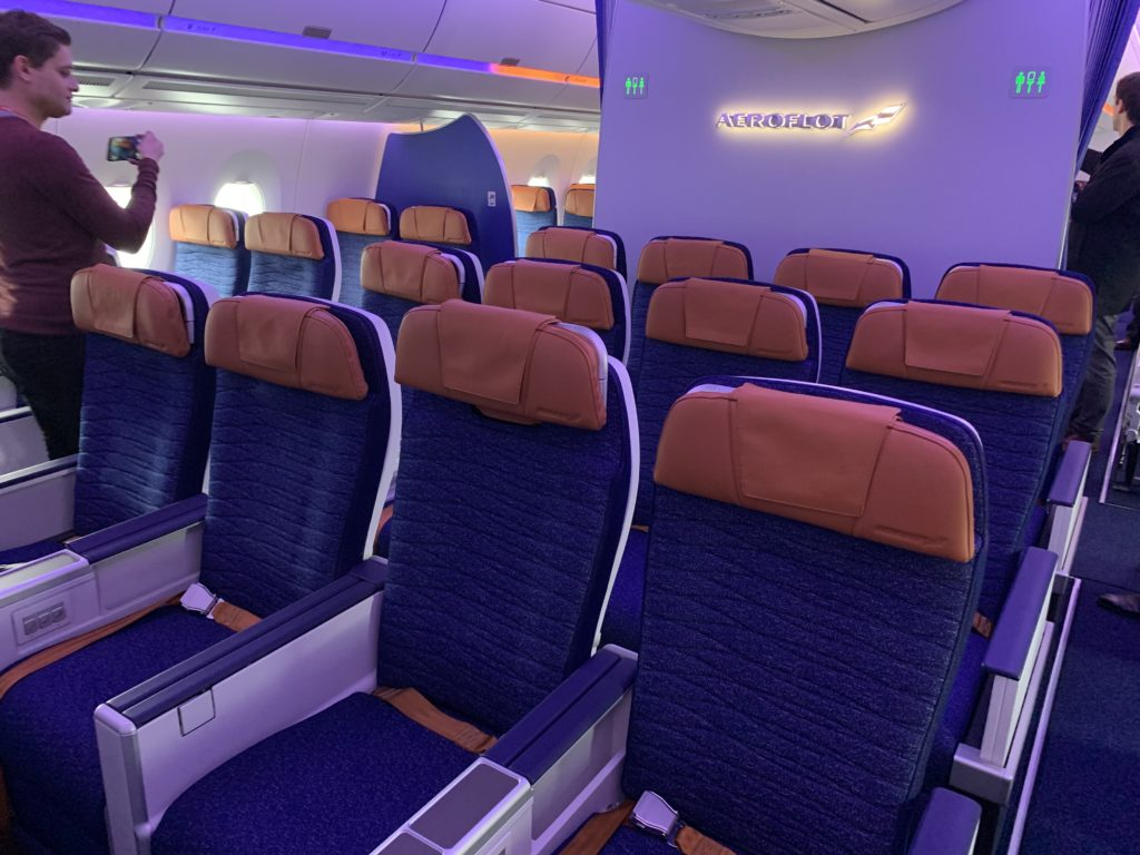 Four Comfort seats with blue fabric and bronze headrests