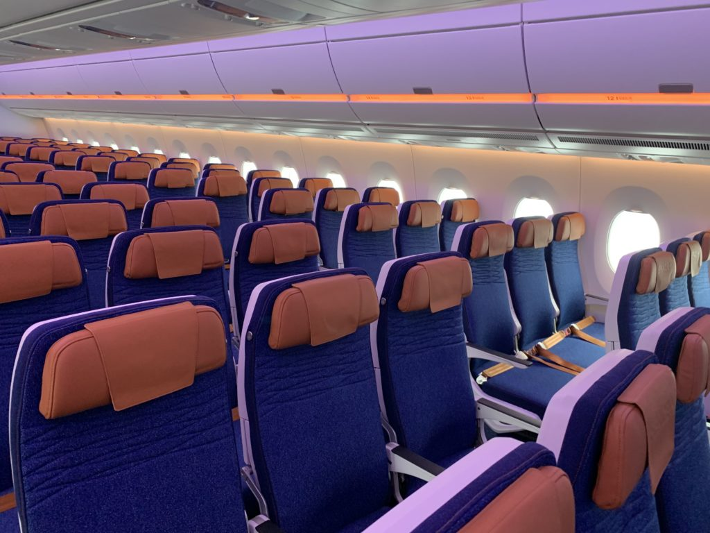 Economy class seats on the A350, with blue fabric and bronze headrests