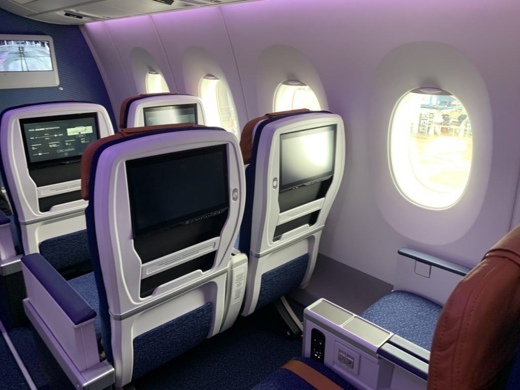 Comfort class seats showing the back of the seats with IFE screens