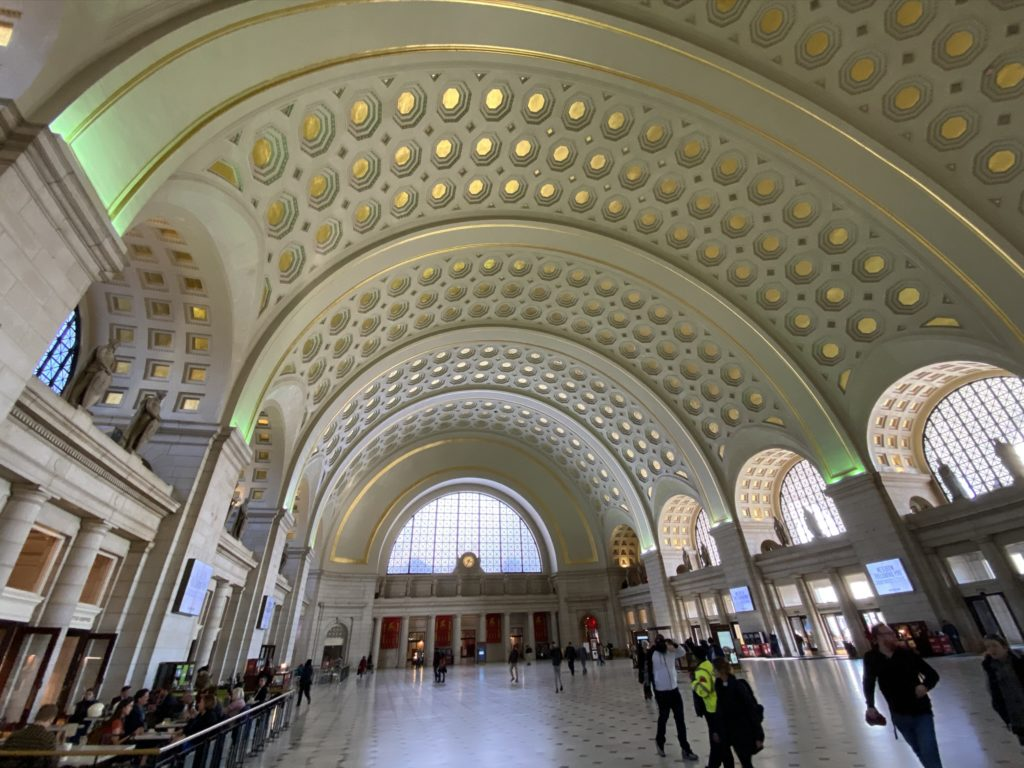 Main Union Station hall with curved ceiling and gold accents