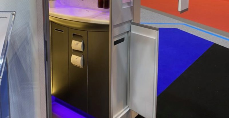A photo of the ST Engineering Arc lavatory, showing a side cubbie for waste, which slides out into the aisle rather than internally in the lav. This allows crew to easily service the lav.