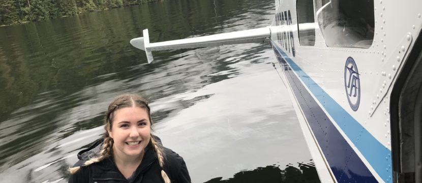 Young woman beside a seaplane