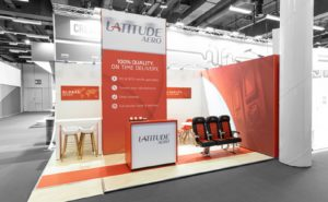 Red and white latitude aero booth at AIX 2019 before people arrive