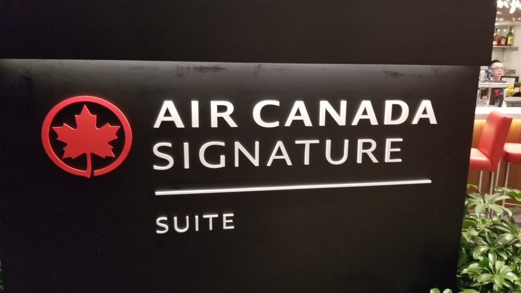 Air Canada Signature Suite entry sign white lettering on a black background with the red maple leaf