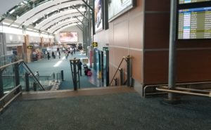 quiet airport with a few scattered passengers