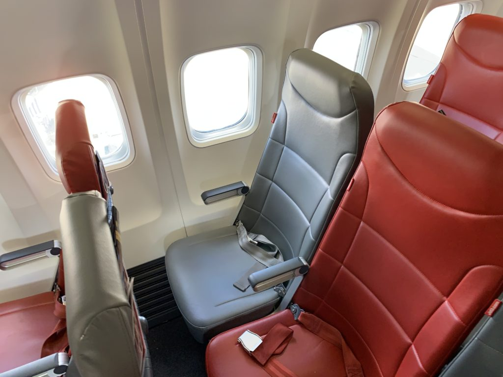 Grey and orange slimline seats on the Jet2 737