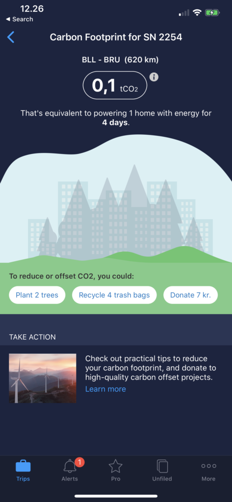 TripIt carbon footprint calculation app screen grab. Blue back ground with carbon footprint data and fadded tress and skyscraper scene