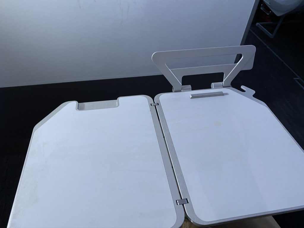 Tray table open and tablet holder displayed empty