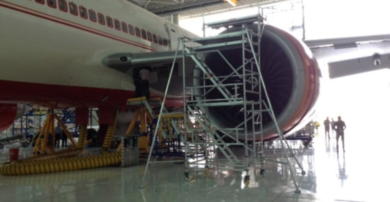 Air India 777 engine receiving MRO work with scaffolding around the engine