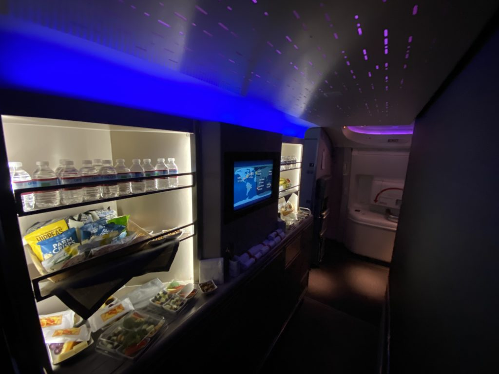 Blue lite galley stocked with water and snacks