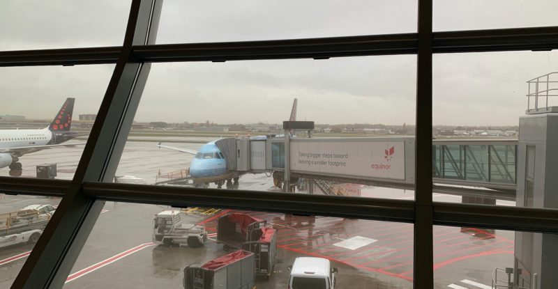 looking out to the jetway bridge from the airport window on a foggy day