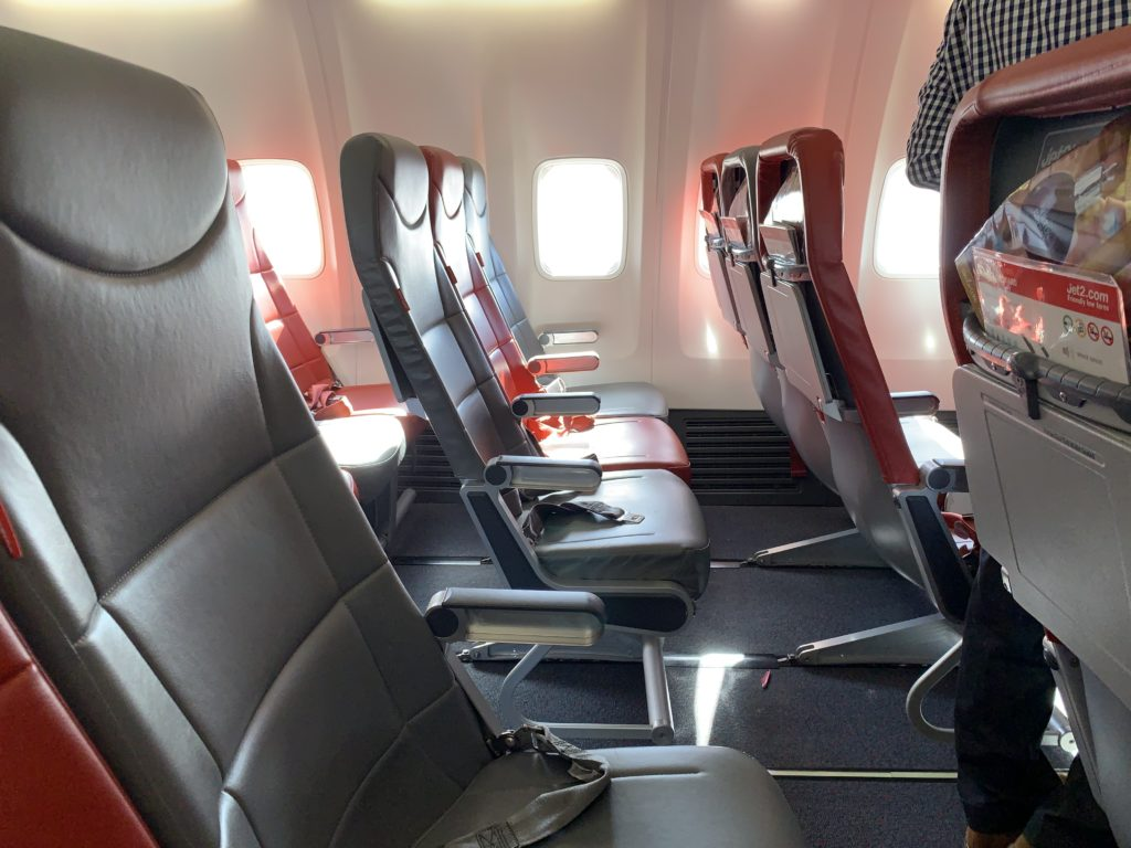 A photo of the legroom on the Jet2 aircraft. Slimline seats carve out more room for knees and shins