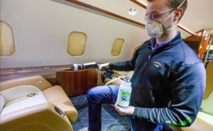 Man cleaning the interior of a business jet