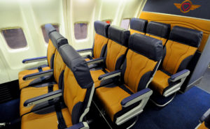 """Southwest Airlines """"Green Plane"""" displaying yellow seats with grey headrest and trim"""