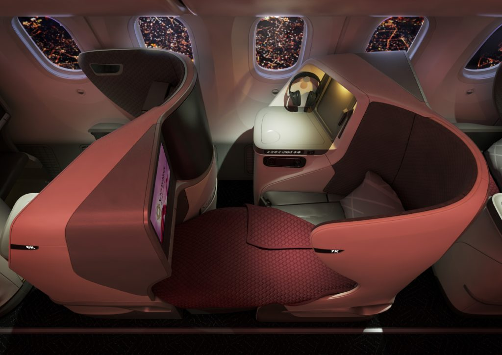 Vistara 787-9 Business Class Flat Bed with soft red lighting and a view of the city out the windows