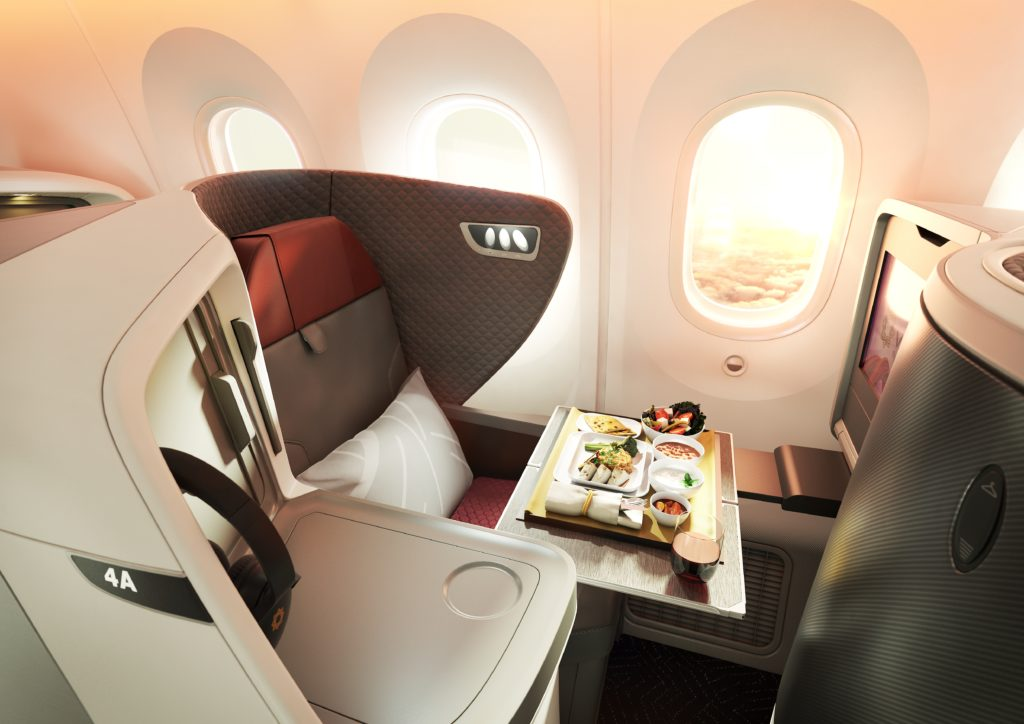 Business class seat on Vistara 787 in upright position with meal tray being served.