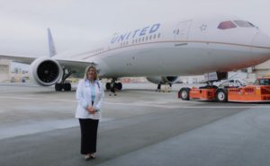 Pat Baylis, managing director and corporate medical director for United Airlines, stands in front of a United aircraft