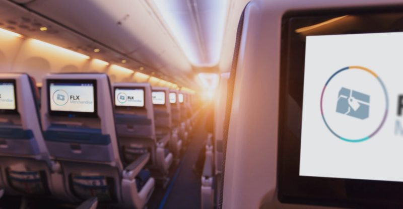Aircraft seats with seatback IFE and FLX branding on each screen