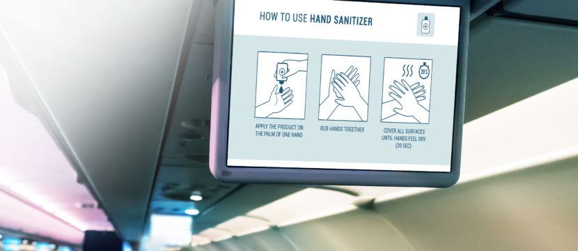 A video about how to use hand sanitizer is shown on a dropdown IFE screen