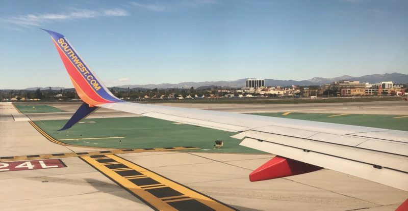 Image of a Southwest 737 wing on takeoff from sunny Tampa