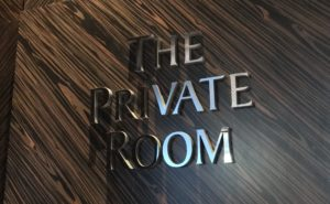"""The words """"The Private Room"""" in raised lettering on the entrance to the lounge"""