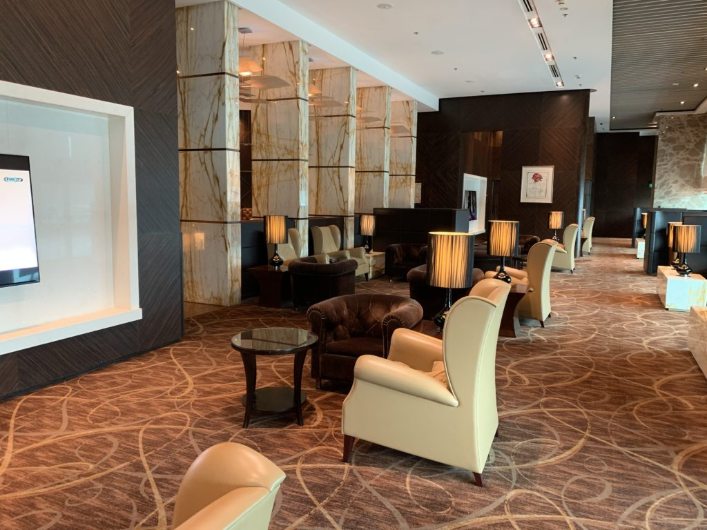 A view of the seating area of The Private Room with soft light ad creamy leather chairs
